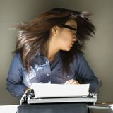 Woman with typewriter. Stock Image