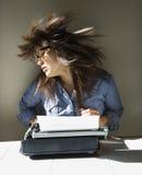 Woman with typewriter. Stock Photos