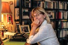 Woman typewriting Stock Photo