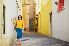 Woman on a typical street of Lisbon, Portugal Stock Images