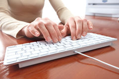 Woman typing Royalty Free Stock Image