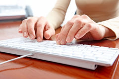 Woman typing Royalty Free Stock Photos