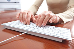 Woman typing Stock Images