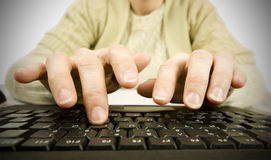 Woman typing Royalty Free Stock Photography