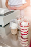 Woman typing on cash register. Woman Cashier at Confectionery shop Stock Images