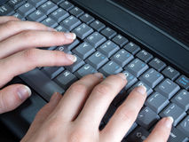 Woman typing on computer keyboard Royalty Free Stock Images