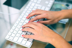 Woman Typing in her Laptop Stock Image