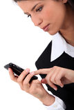 Woman typing on her mobile Stock Photos