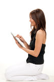 Woman typing on her new electronic tablet touch Stock Images