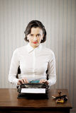 Woman typing in her office Stock Image