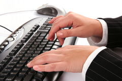Woman typing on the keyboard Royalty Free Stock Photos