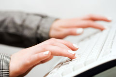 Female hands typing on computer keyboard Royalty Free Stock Photos