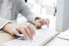 Woman typing on keyboard Royalty Free Stock Images