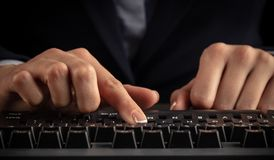 Woman typing on keyboard stock photography