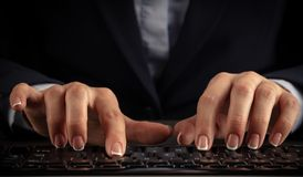 Woman typing on keyboard royalty free stock photos