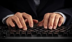 Woman typing on keyboard stock photos
