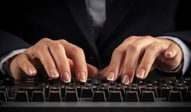 Woman typing on keyboard. Business woman typing on keyboard stock photography