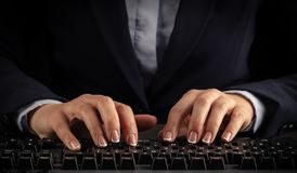 Woman typing on keyboard. Business woman typing on keyboard stock images