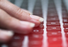 Woman typing on keyboard Stock Image