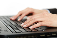 Woman typing on keyboard, closeup. Closeup of woman`s hands over laptop keyboard, typing Royalty Free Stock Image