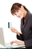 Woman typing on keyboard and holding credit card Stock Photography