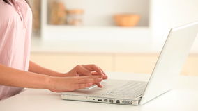 Woman typing on a keyboard stock video footage