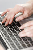 Woman typing on keyboard Stock Photo