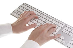 Woman typing on keyboard Stock Images