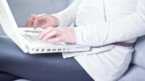 Woman typing on the keyboard stock footage