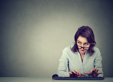 Woman typing on the keyboard wondering what to reply. Business woman typing on the keyboard wondering what to reply royalty free stock photo