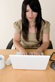 Woman typing on a laptop Stock Photos