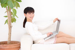 Woman typing laptop Stock Photo