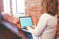 Woman typing on laptop Stock Image