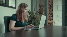 Woman Typing on a Laptop Computer stock video footage