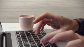 Woman typing on laptop. DNIPRO, UKRAINE - JANUARY 20, 2015: woman typing on laptop and drinking a coffee, Dnipro, January 2015 stock footage