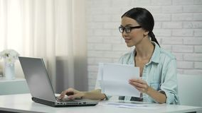 Woman typing on laptop at home, paying for utilities or checking correspondence. Stock footage stock video