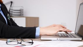 Woman typing on laptop keyboard. Close up of woman typing on laptop keyboard in her office stock footage