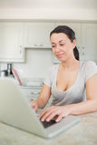 Woman typing on a laptop Royalty Free Stock Photo