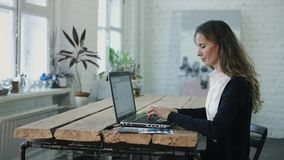 The woman typing by laptop stock video footage