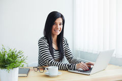 Woman typing on laptop in office Royalty Free Stock Image