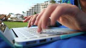 Woman Typing On A Laptop Outdoor stock footage