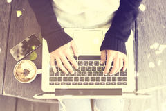 Woman typing on a laptop Royalty Free Stock Image