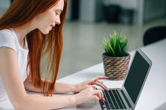 Woman typing on laptop at workplace Woman working in home office hand keyboard Stock Images