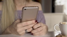 Woman typing message on smartphone. Close up stock video footage