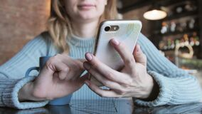 Woman typing message sms on touch phone close up. Using mobile. Women using mobile Phone in cafe stock video