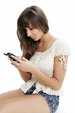 Woman typing on phone Royalty Free Stock Images
