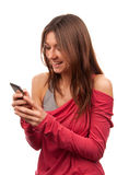Woman typing and sending SMS on mobile cellphone Stock Photo