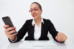 Woman typing on smart phone Stock Images