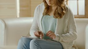 Woman typing on tablet, choosing hotel apartment for vacation, shopping online. Stock footage stock video footage