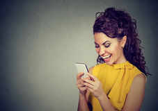 Woman typing text message on smartphone having a pleasant conversation. Woman typing text message on smart phone having a pleasant conversation Royalty Free Stock Image